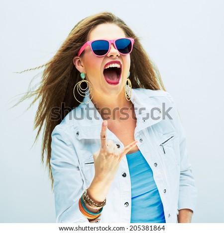Screaming fashion model studio portrait. Long hair. Rock style. - stock photo