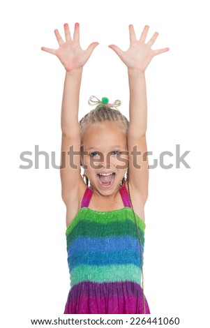 Screaming girl with her �¢??�¢??hands raised. Girl is six years old. - stock photo