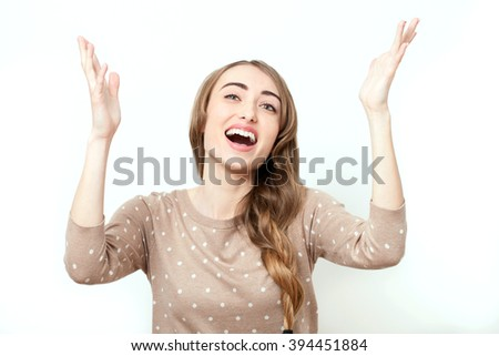 Screaming lady, emotions. Face with toothy smile. Woman in stylish clothes to make-up and hairstyle in studio isolated. Bright positive emotions of young woman and raised his hands up in prayer