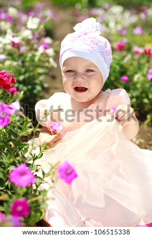 Screaming little baby in flowers field