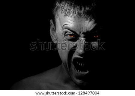 Screaming man possessed by demon - stock photo
