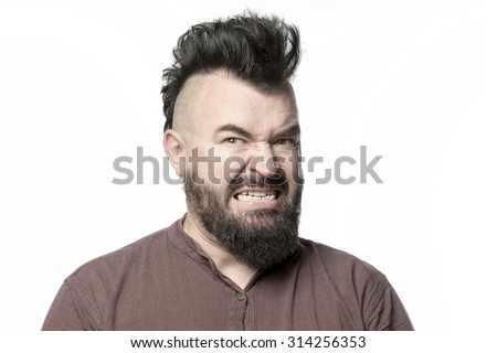 Screaming man with a mohawk and beard, isolated