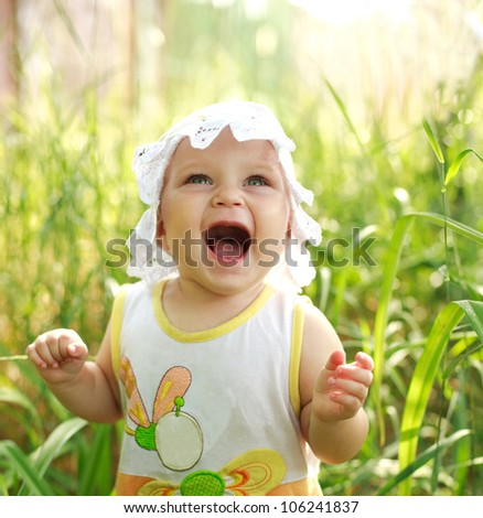 Screaming of baby lost in green meadow
