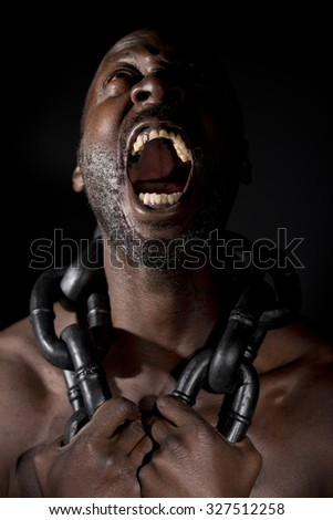Screaming Slave In Chains - stock photo