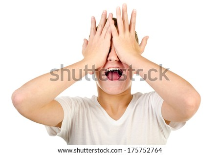 screaming teenage boy isolated on a white background - stock photo