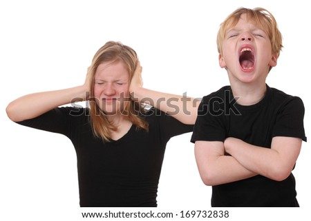Screaming young boy and girl covering her ears - stock photo