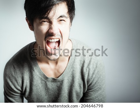 Screaming young man. - stock photo