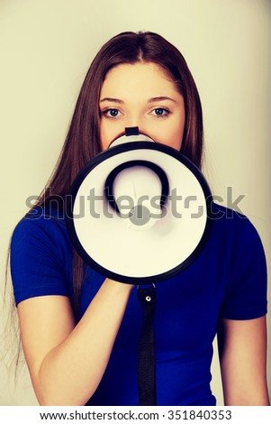 Screaming young teenage woman with megaphone.