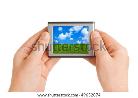 Screen with landscape (my photo) in hands isolated on white background - stock photo