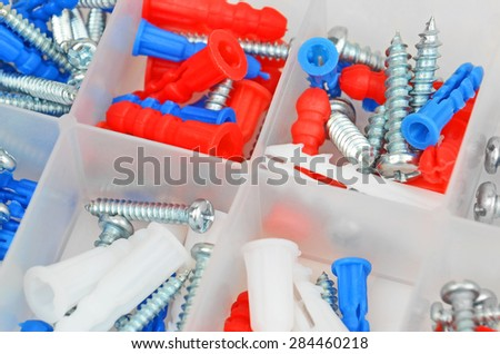 Screw and dowel in plastic organizer box