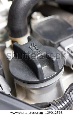 Screw cap of oil in engine. - stock photo