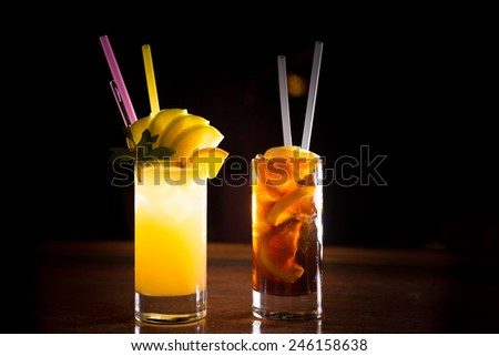 Screw driver and cuba libre cocktails in a tall glasses on the dark background. Shallow DOF - stock photo
