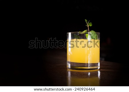 Screw driver cocktail with fresh mint on the dark background. Shallow DOF - stock photo