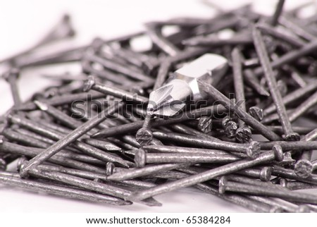 Screw Driver Head in Pile of Nails - stock photo