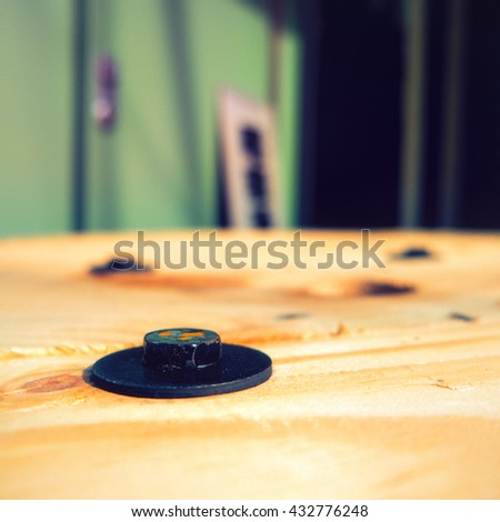 Screw on wooden board. Close up. - stock photo