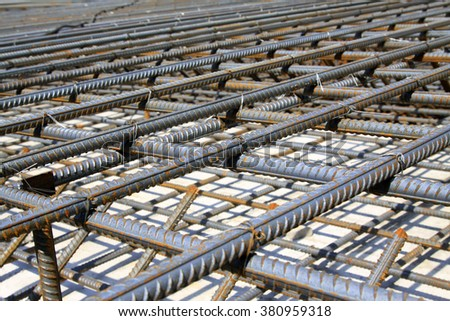 Screw thread steel bar framework, in the construction site - stock photo