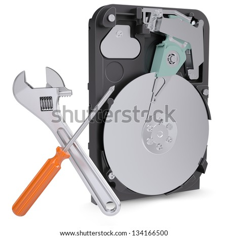 Screwdriver and wrench on the background of the disclosed hard drive. Isolated render on a white background - stock photo