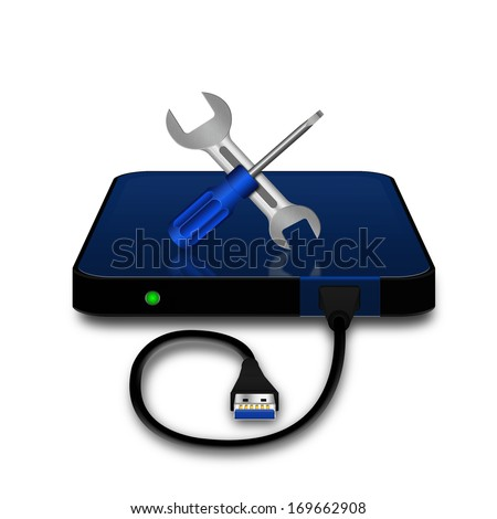 Screwdriver and wrench with portable external hard disk  - stock photo