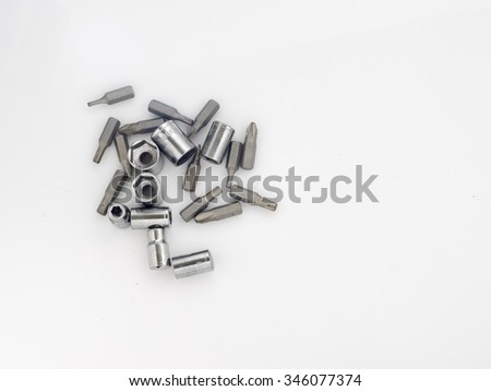 Screwdriver bits and socket over a white background,top view