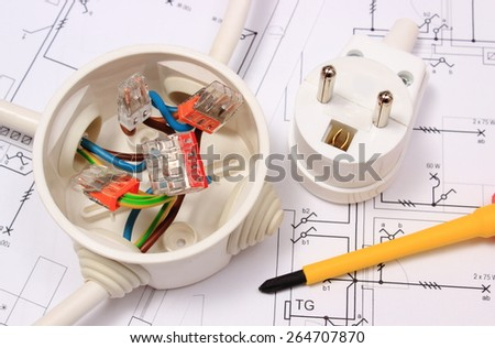 Screwdriver, copper wire connections in electrical box and electric plug on construction drawing of house, accessories for engineering work, energy concept - stock photo