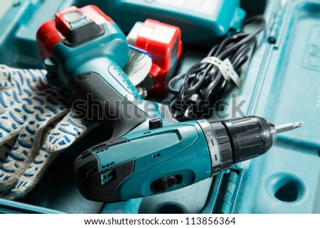 Screwdriver in the box with gloves - stock photo