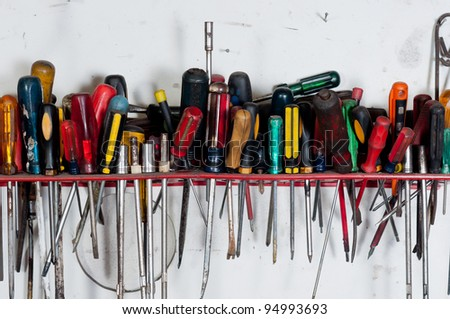 Screwdrivers against white wall hanging