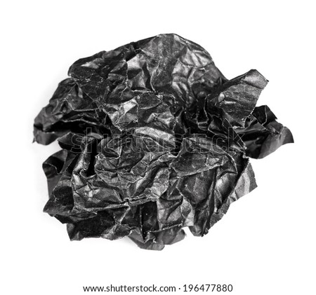 Screwed up piece of black paper isolated - stock photo