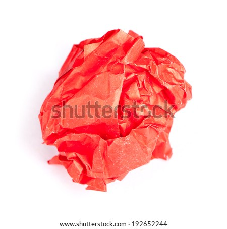 Screwed up piece of red paper isolated on white background - stock photo