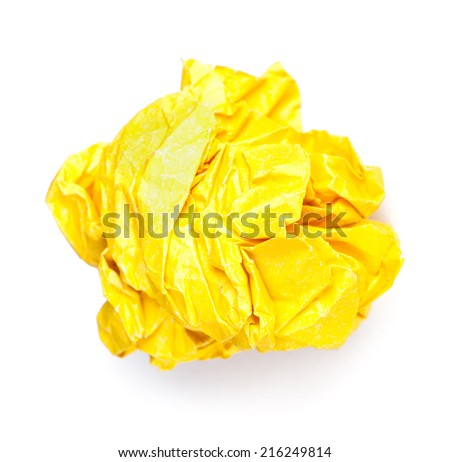 Screwed up piece of yellow paper isolated - stock photo