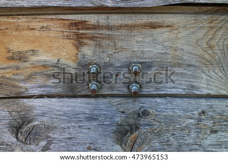 Screws and bolts on wooden door