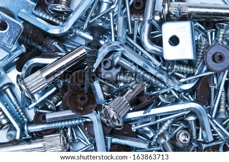 Screws and nails as backdrop