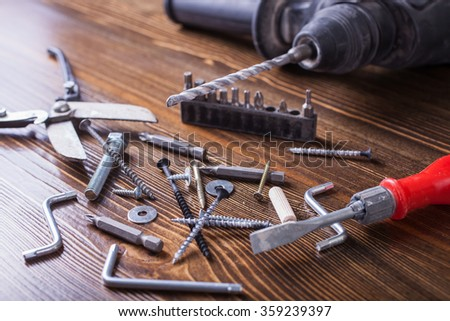 screws, bolts and the tool on a table, selective focus