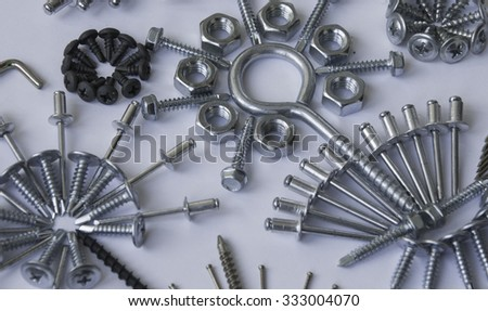 screws, bolts, nails, dowels, rivets, nuts, background - stock photo