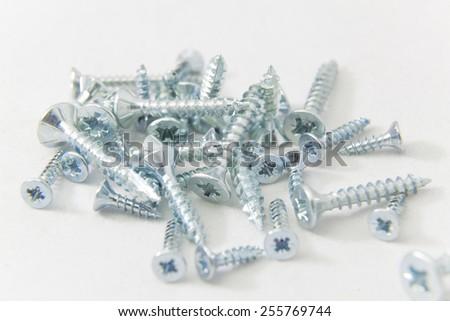 Screws in white background - stock photo