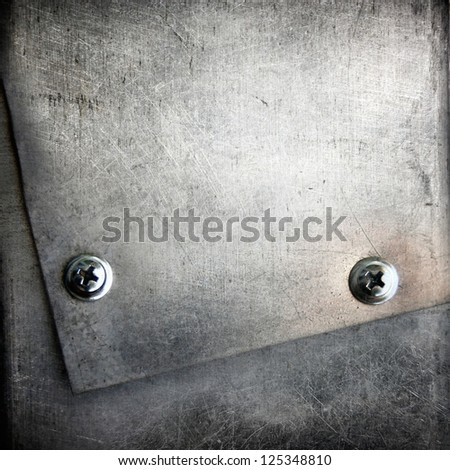 screws on grunge metal texture ; abstract industrial background - stock photo