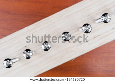 screws screwed in wood plate