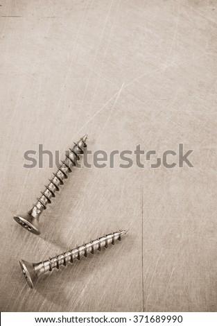 screws tool at metal background texture - stock photo