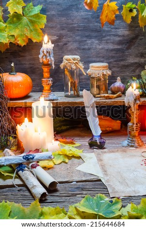 Scribe desk full of recipes and candles - stock photo