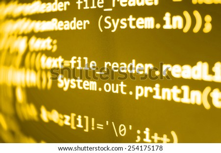 Script on computer. Modern display of data source code. Programming code abstract screen of software developer.  Yellow golden orange color.  - stock photo