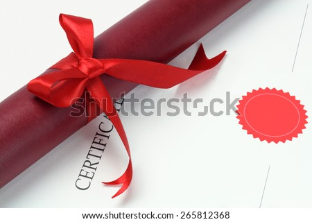 Scroll Container Lying On Graduation Certificate With Copy Space - stock photo