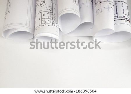 Scrolls of architectural drawings. The desk architect - stock photo