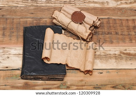 Scrolls of vintage paper with seal wax - stock photo