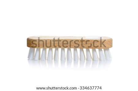 Scrub brush with polyester white  bristles and wood handle against