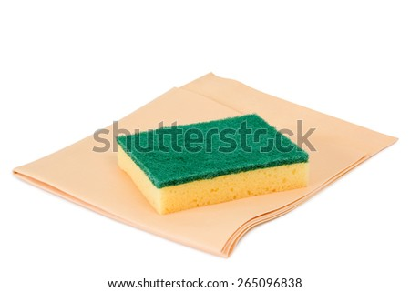 Scrubbing sponge and leather cloth on white background - stock photo