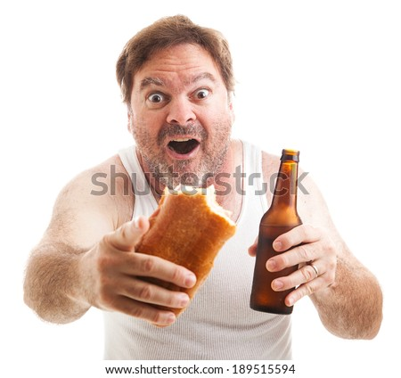 Scruffy man watching a sporting event, holding a sub sandwich and a beer.  Isolated on white.   - stock photo