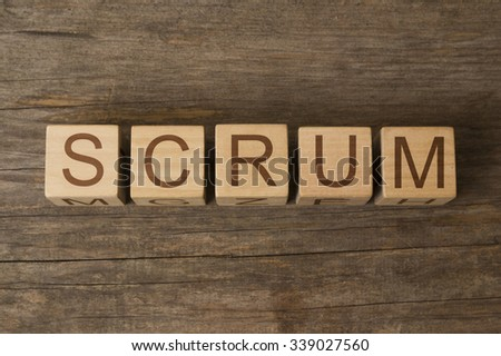 SCRUM text on a wooden background - stock photo