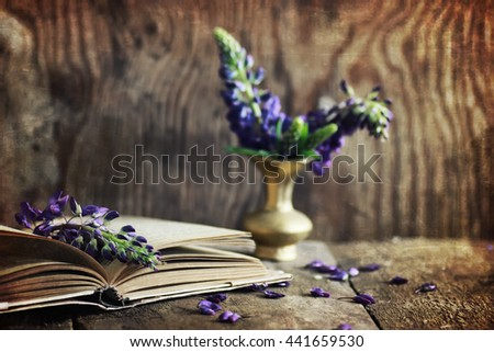sctrathes effect on photo retro book on wooden table key - stock photo
