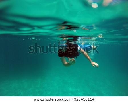 Scuba diver by Bora Bora, South Pacific Ocean, French Polynesia - stock photo