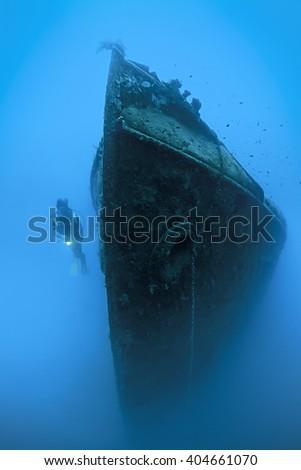 Scuba diver exploring shipwreck named Paris II   - stock photo