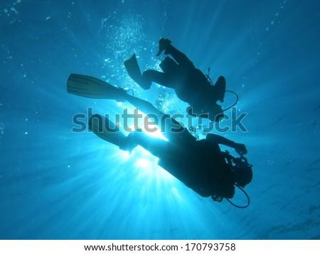 Scuba diver's shadow - stock photo